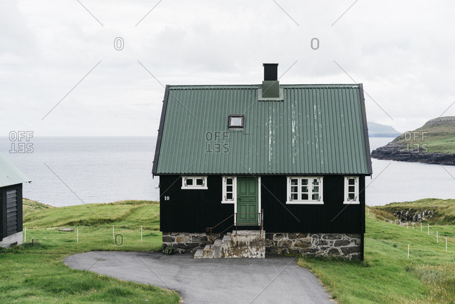 Black house on the coast of the Faroe Islands