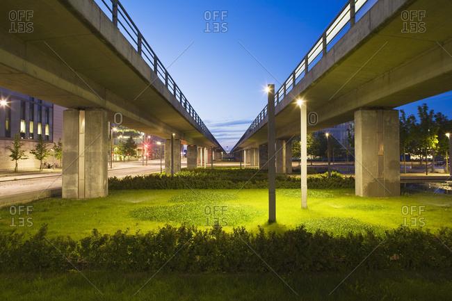 Bridges over Illuminated grass in city at twilight