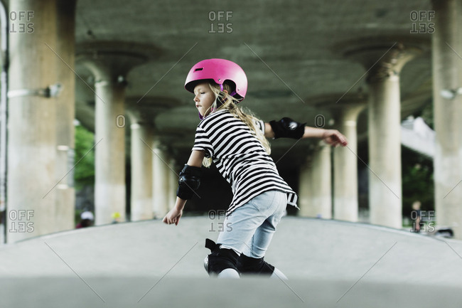 Low angle view of confident girl skateboarding at park