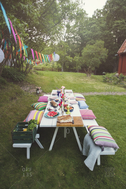 High angle view of decorated picnic table in backyard at garden party
