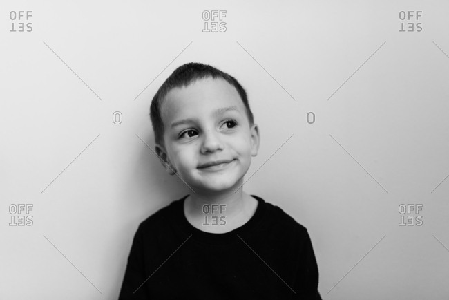 Little boy in a black t-shirt smirking