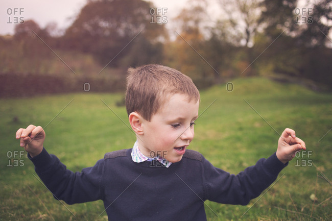 Portrait of a smiling boy snapping his fingers
