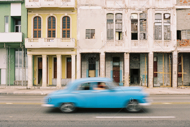 Havana, Cuba - March 20, 2017: Vintage car driving fast on city street
