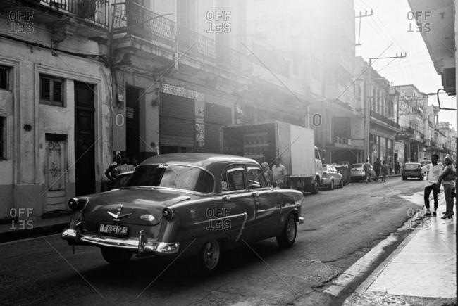 Havana, Cuba - March 20, 2017: Classic car driving on busy street