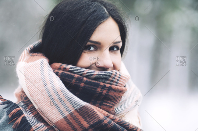 Close-up portrait of woman wrapped in scarf