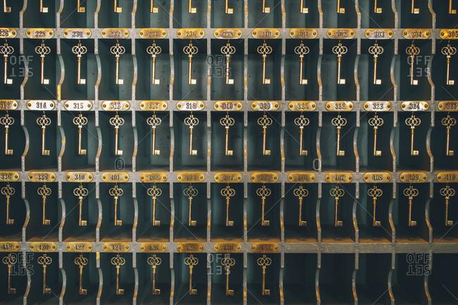 Hotel keys hanging on hooks at hotel