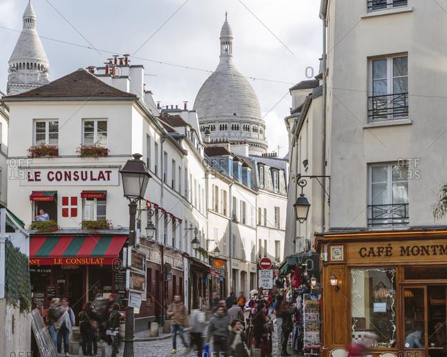 France, Ile de France, Paris - November 9, 2015: People on alley amidst buildings in city