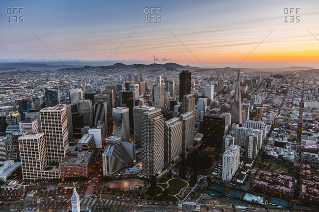High angle view of skyscrapers in city against sky during sunset