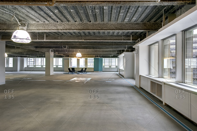 An empty commercial space with a sitting area