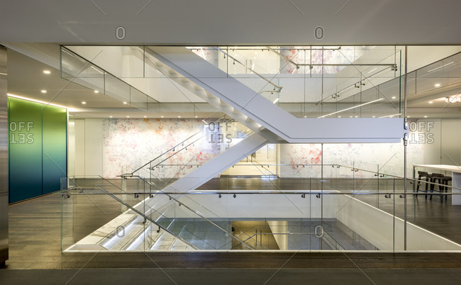 A floating staircase with large glass walls