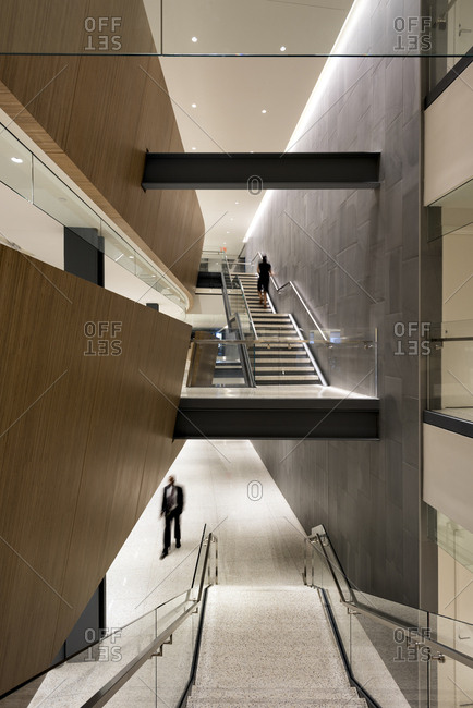 People rush through a staircase