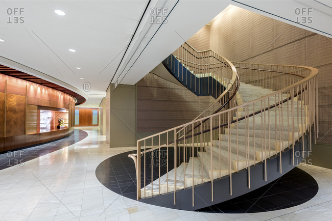 A winding staircase in an office lobby