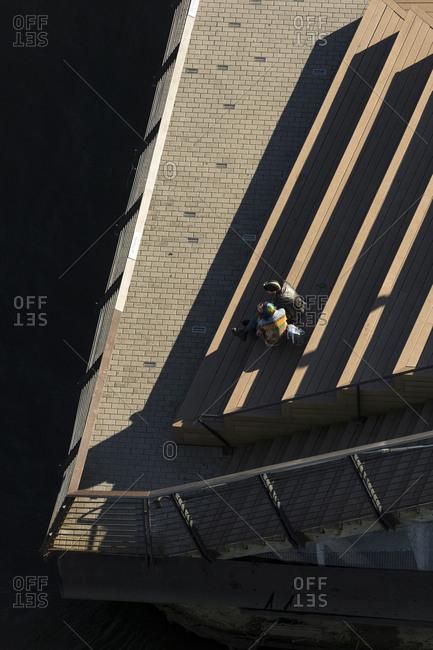 Philadelphia, Pennsylvania - October 9, 2016: A couple sits on Race Street Pier in Philadelphia