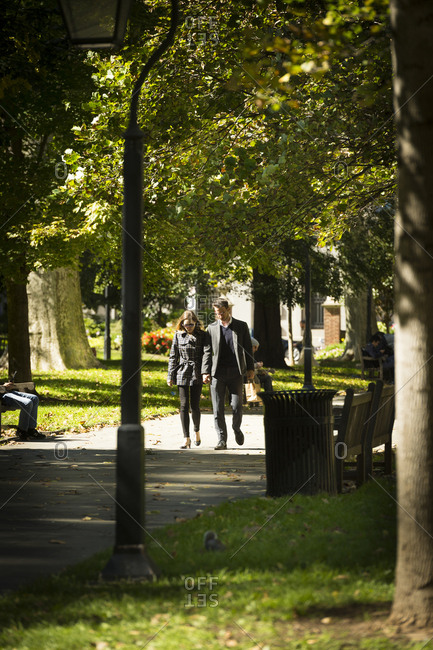 Philadelphia, Pennsylvania - October 10, 2016: A couple walks in a park