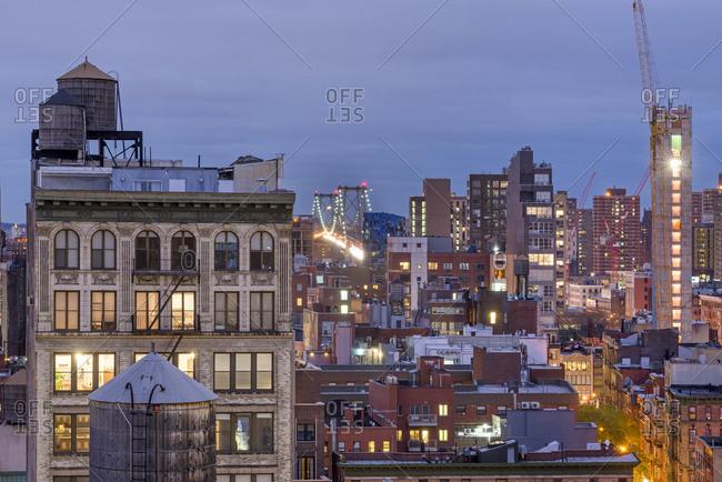 New York, New York - December 1, 2016: New York City rooftops with the Williamsburg bridge