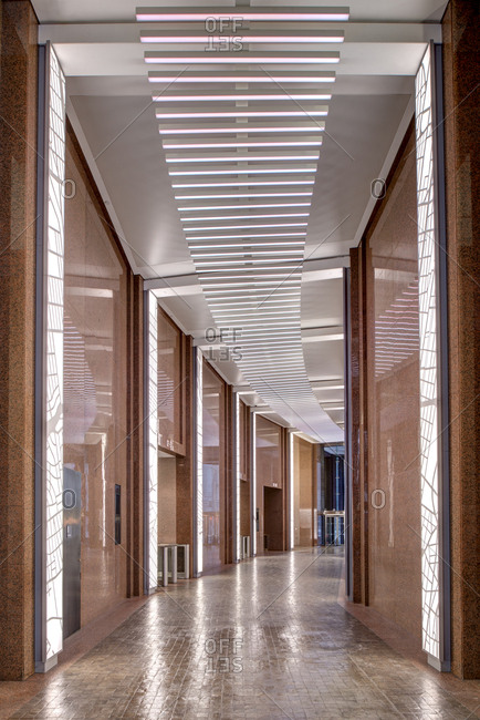 ... recessed lighting New York New York - January 7 2017 A long hallway with glowing & recessed lights stock photos - OFFSET