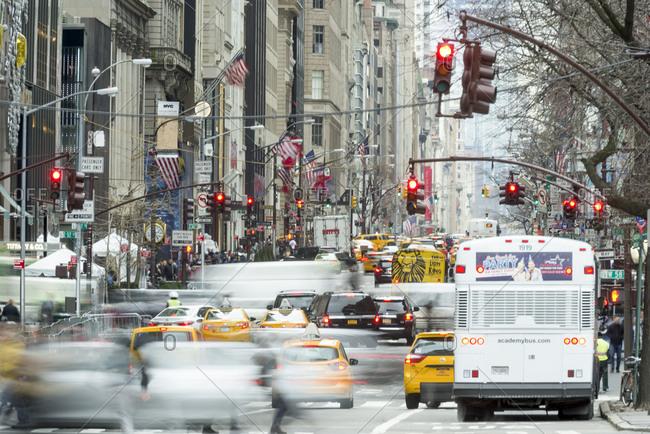 New York, New York - January 19, 2017: Traffic speeds down fifth avenue
