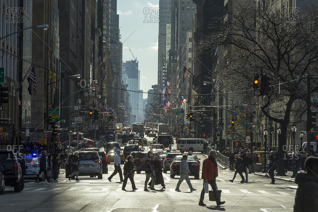 New York, New York - January 25, 2017: A view down a busy fifth avenue street