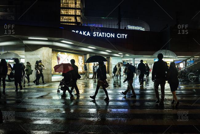 Osaka, JAPAN - November 9, 2014: Rainy night in Osaka Station.