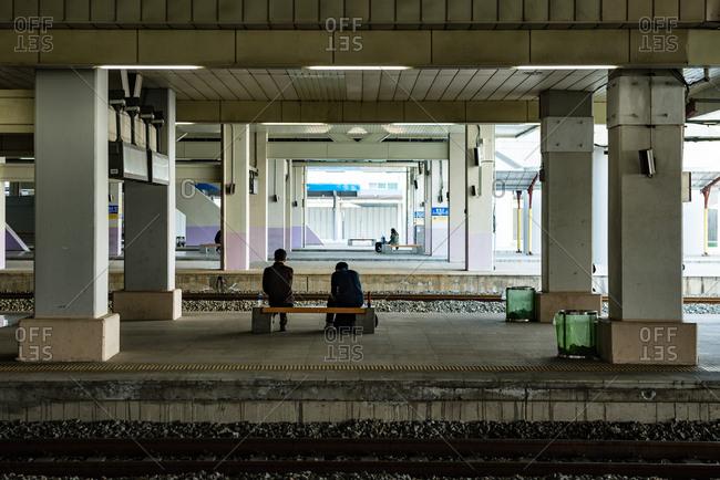 People waiting for trains at Dongdaegu Station, South Korea.