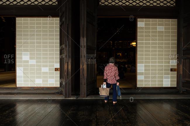 Kyoto, JAPAN - July 12, 2015: Elderly woman in the Higashi Honganji temple.