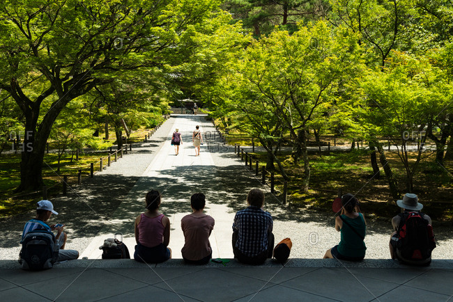 Kyoto, JAPAN - July 14, 2015: Tourists sit and rest on steps.