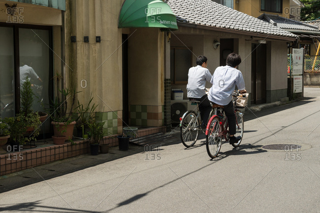 Kyoto, JAPAN - July 14, 2015: School boys riding bicycle.