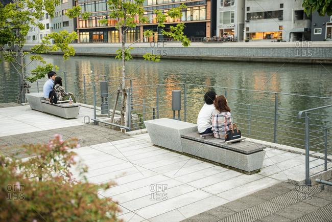 Osaka, JAPAN - September 12, 2015: Couples relaxing by Tosabori river, Osaka.