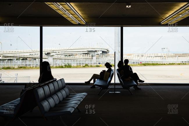 Osaka, JAPAN - October 6, 2015: People waiting at Kansai International Airport.