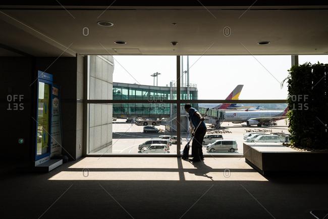 Incheon, KOREA - October 6, 2015: Window cleaner at Incheon international airport.