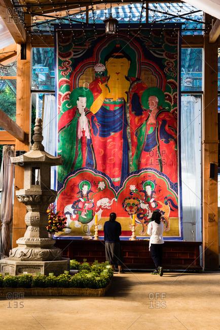 Seoul, KOREA - October 8, 2015: Visitors praying Bongeunsa Temple in Gangnam district, Seoul.