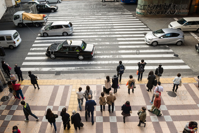 Osaka, JAPAN - December 2, 2015: People wait to cross the road, Osaka.