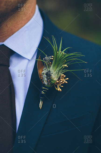 Close-up of groom wearing a boutonniere on lapel