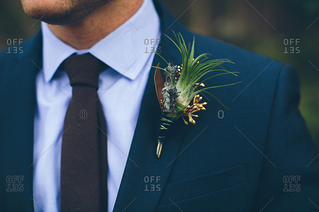 Groom wearing a boutonniere on lapel of jacket