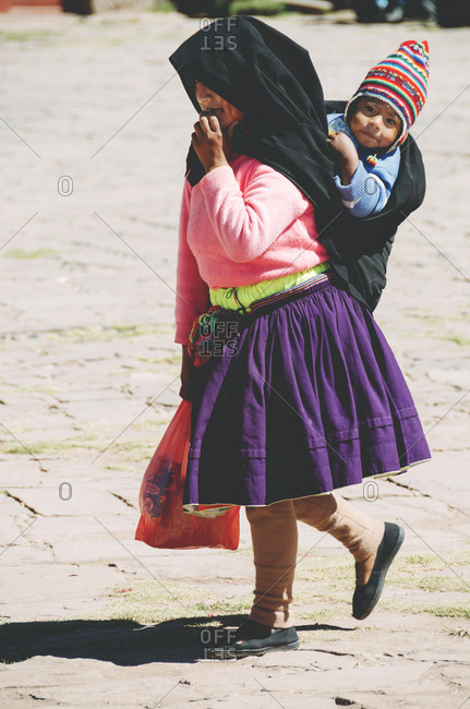 Taquile Island, Lake Titicaca, Peru - May 19, 2015: Peruvian woman with child