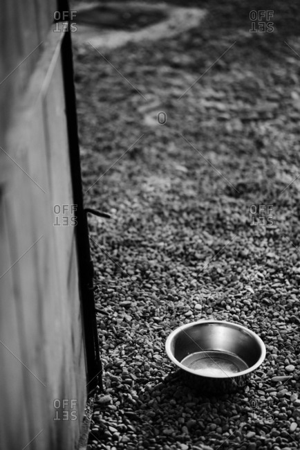 Empty metal dog bowl outdoors