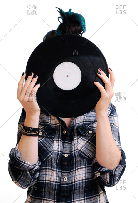 Girl holding a record in front of her face