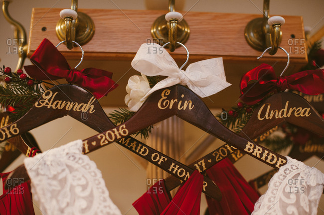 Bridal gowns on hangers with names