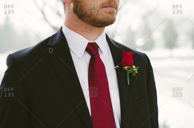 A groom in a red tie