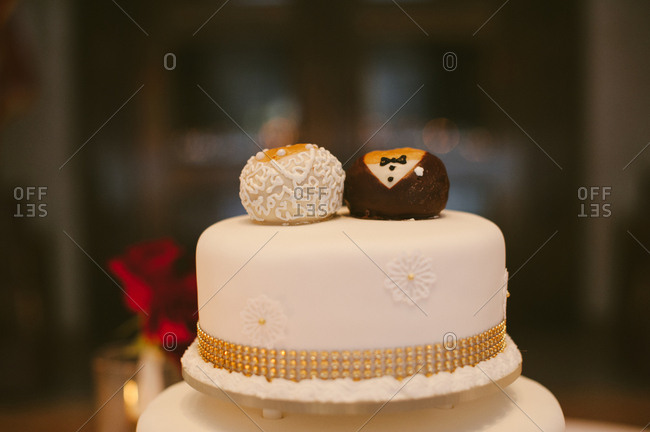 Bride and groom cake toppers on cake
