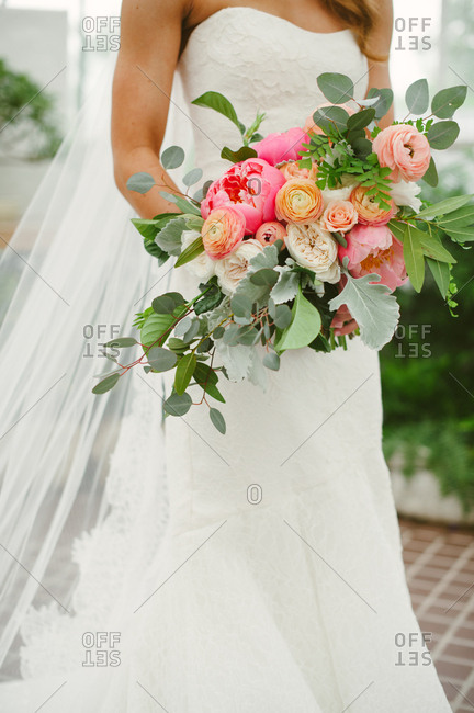 Bride with ornate wedding bouquet