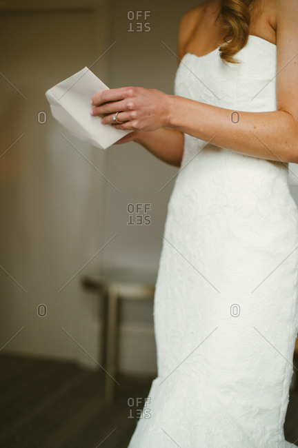 Bride opening up an envelope