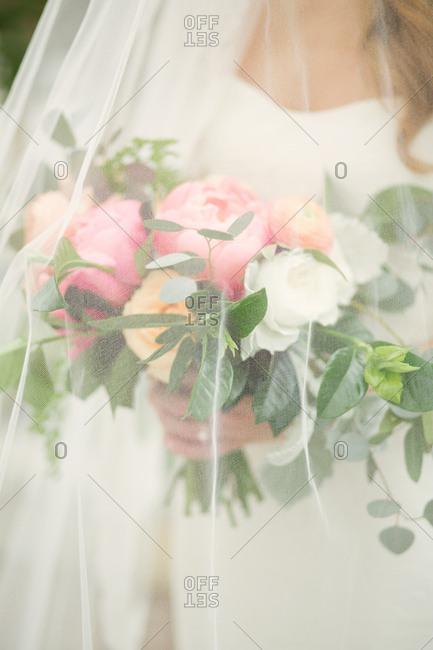 Bride's bouquet under her veil
