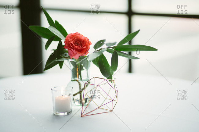 Single flower on wedding reception table