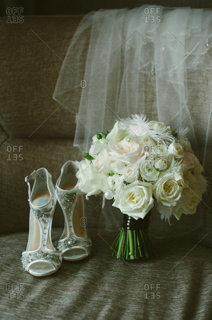 White floral bouquet by high heels