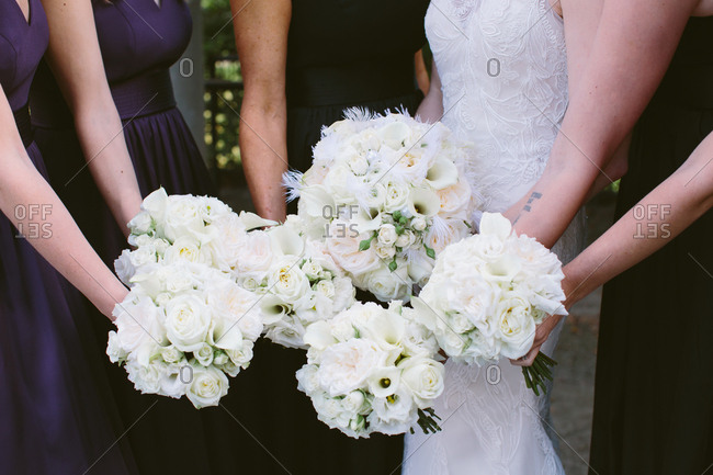 White bouquets held by bridal party