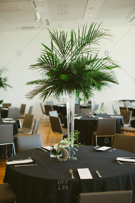 Silk palm plants on wedding reception table
