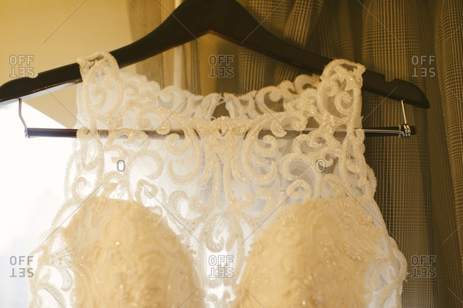 Bridal gown with curlicue lace