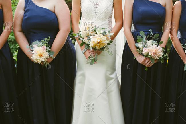 Bridal party holding dahlia bouquets