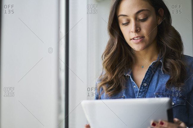 Young businesswoman using digital tablet in creative office